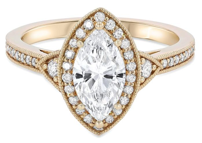Vintage Milgrain marquise diamond ring accented with .31 total cts. round diamonds set in 14K yellow gold from Diamonds Direct ($1,970)