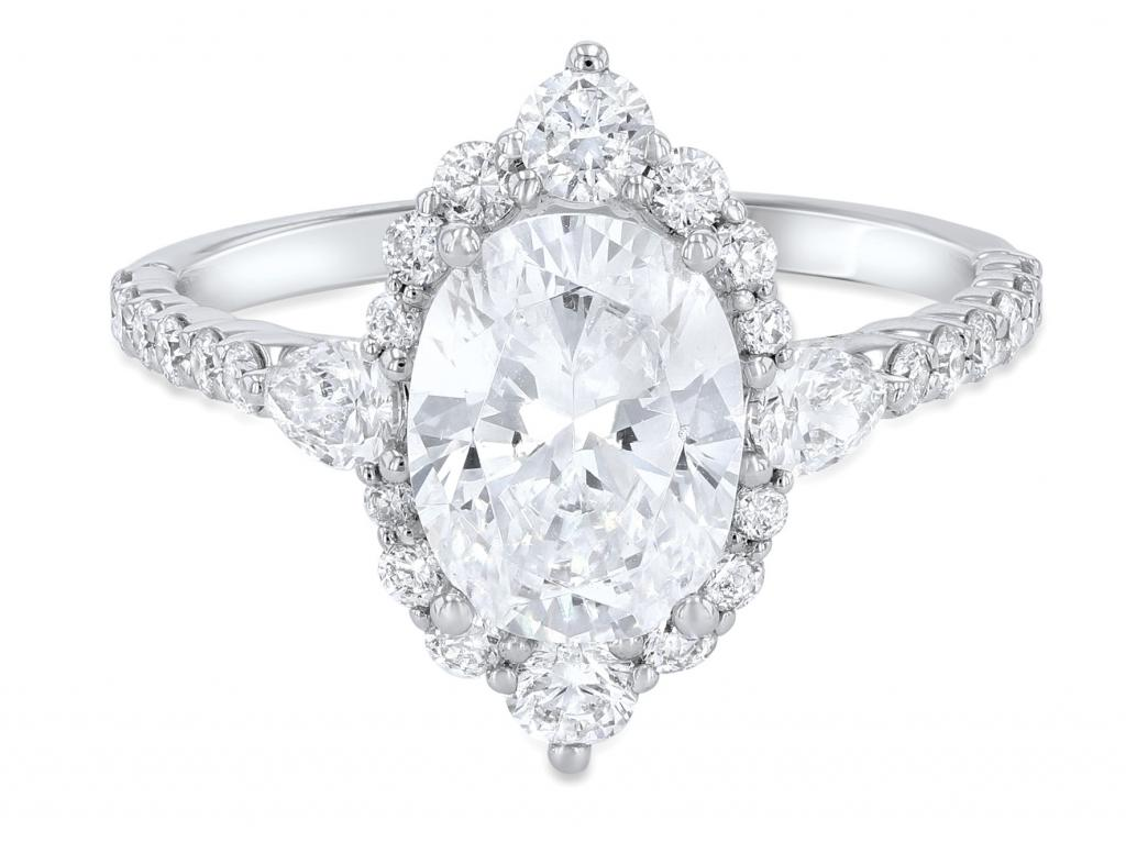 Vintage oval diamond accented by round- and pear-cut diamonds (.72 total cts.) in 14K white gold from Diamonds Direct ($2,450)
