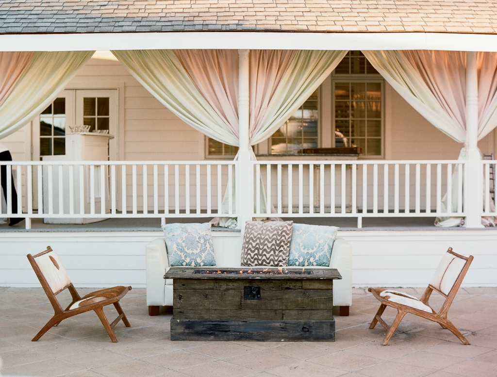 One way to make a large, open space feel more intimate? Add curtains, as Ooh! Events did to the porches.