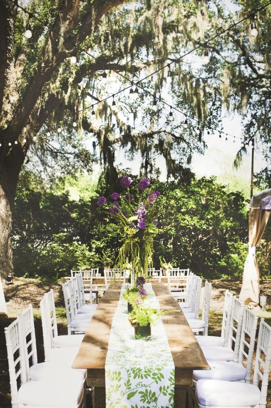 TALL ORDER: Katharine fell in love with the humble, long-stemmed allium (garlic plant), and its purple blooms inspired the wedding's dominant colors: green and lavender.