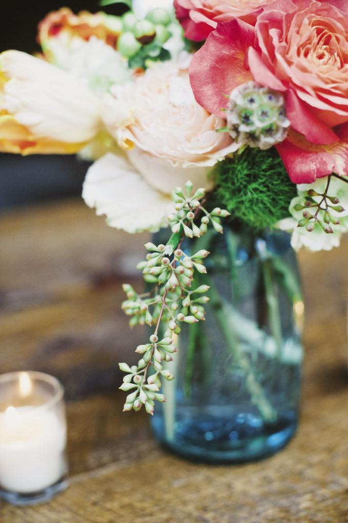 FLOWER POWER: Sara's relatives arranged small bouquets to accompany the larger florals created by Ooh! Events.