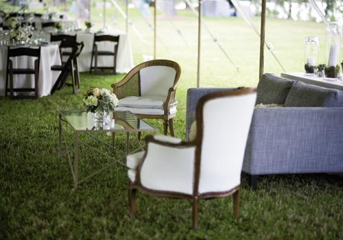 "TAKE A SEAT: With silvery blue and ivory lounge furniture, Sarah Katherine says ""the comforts of a beautiful home were brought to the outdoor venue."""