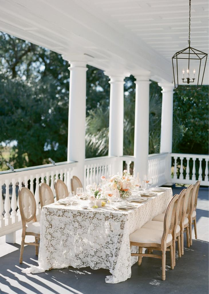 The piazza at Lowndes Grove Plantation is most often used for portraits and cocktail hours; in this imagined wedding, it's ideal for al fresco dining. If you choose a lace with appliqués, consider using place mats and other toppers to create level surfaces.