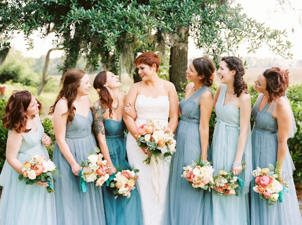 Image by Perry Vaile Photography. Bride's attire by Sottero and Midgley. Bouquets by Rebecca Rose Events.