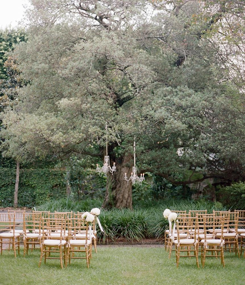 Event design, floral design, and lighting by Gathering Floral + Event Design. Chairs from Snyder Events. Photograph by Marni Rothschild Pictures at the William Aiken House.