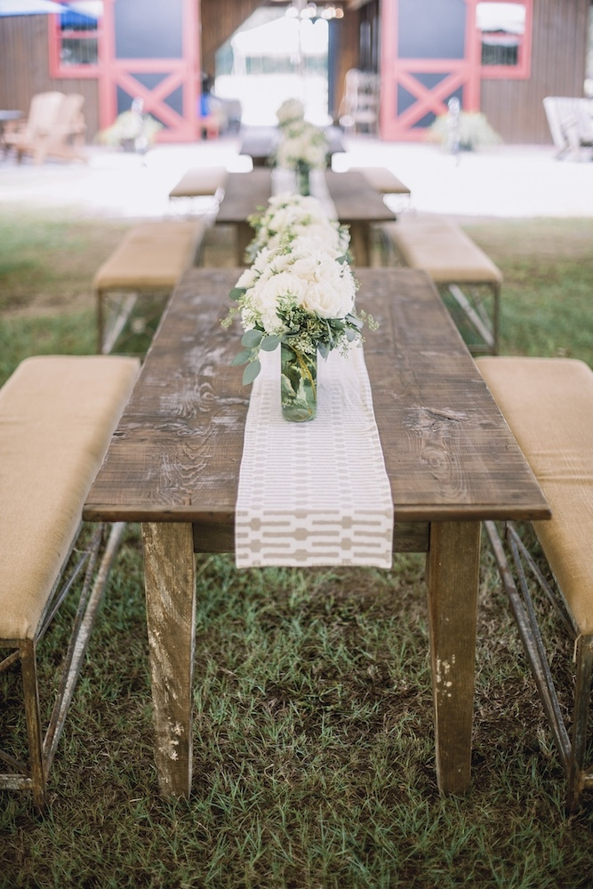 Wedding design and décor by Ooh! Events. Florals by Out of the Garden. Image by Timwill Photography at Hyde Park Farm & Polo Club.