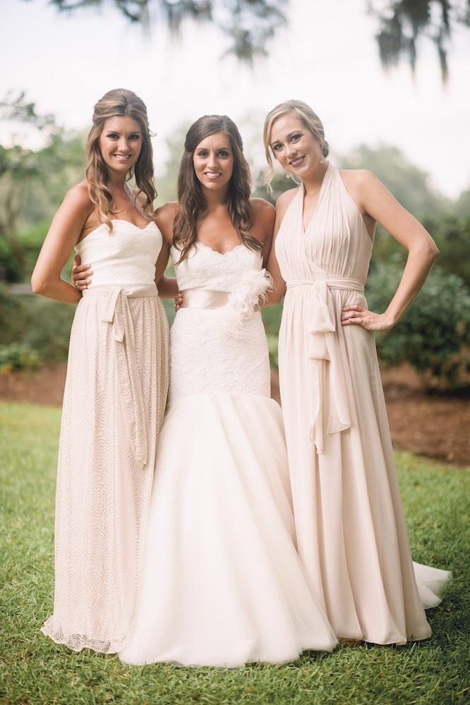 Bride's gown by Legends by Romona Keveza (available locally through Maddison Row). Bridesmaid dresses from Bella Bridesmaids. Image by Timwill Photography at Hyde Park Farm & Polo Club.