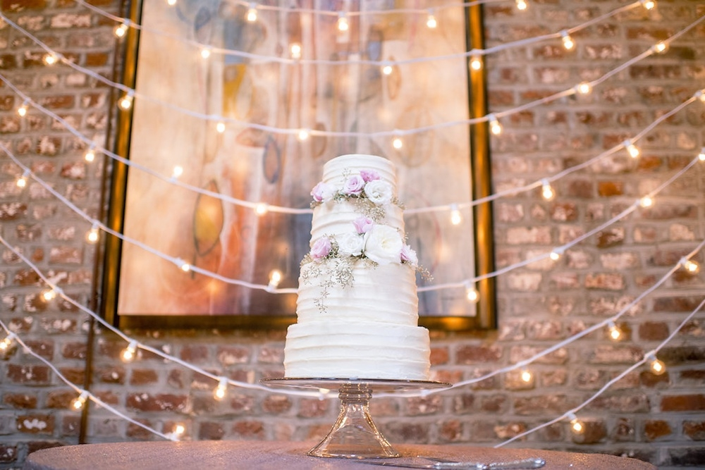 Cake by Chocolate Cake. Lighting by Technical Event Company. Image by Timwill Photography at McCrady's Restaurant.