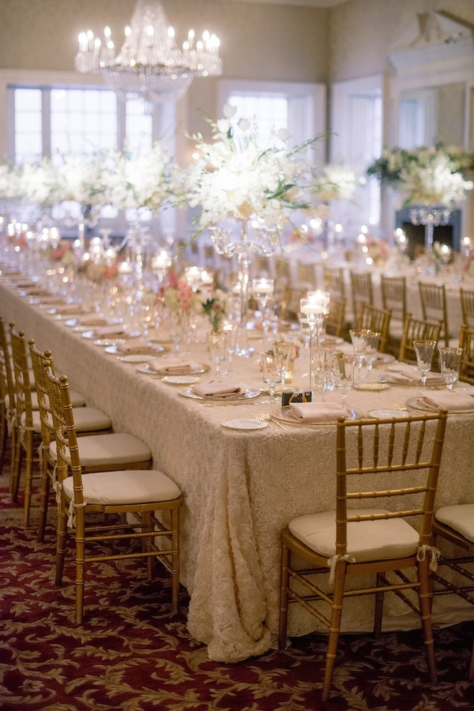 Wedding design by Sage Innovations. Florals by Branch Design Studio. Chairs from Snyder Events. Flatware, china, and chargers from EventWorks. Linens from I Do Linens. Image by Timwill Photography at McCrady's Restaurant.