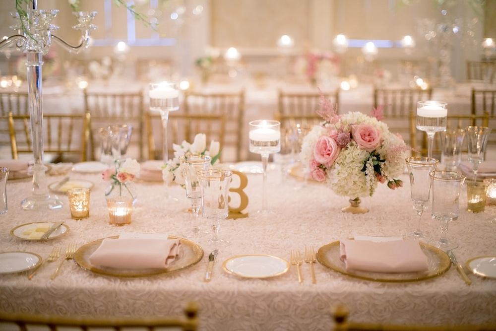 Wedding design by Sage Innovations. Table numbers by Z Create Designs. Florals by Branch Design Studio. Chairs from Snyder Events. Flatware, china, and chargers from EventWorks. Linens from I Do Linens. Image by Timwill Photography at McCrady's Restaurant.
