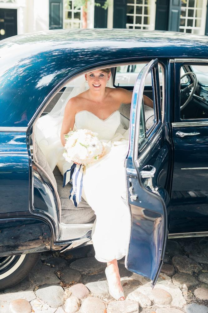 Vehicle from Lowcountry Valet & Shuttle Co. Bride's gown by Issa. Image by Corbin Gurkin Photography.
