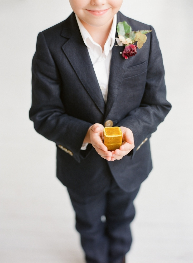 Ring bearer's suit from J.Crew. Boutonniere by Charleston Stems. Image by Corbin Gurkin Photography.
