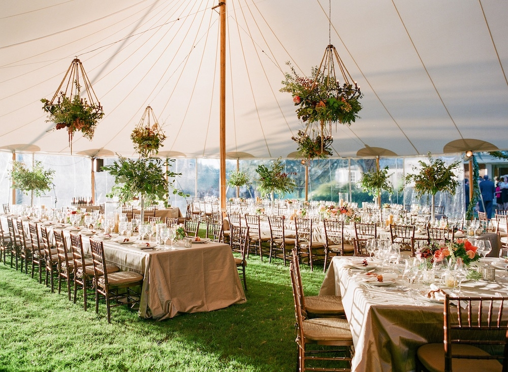 Wedding design by Easton Events. Florals by Charleston Stems. Tent by Sperry Tents Southeast. Chiavari chairs and tables from Festive Fare. Linens from La Tavola. Image by Corbin Gurkin Photography at Yeamans Hall Club.