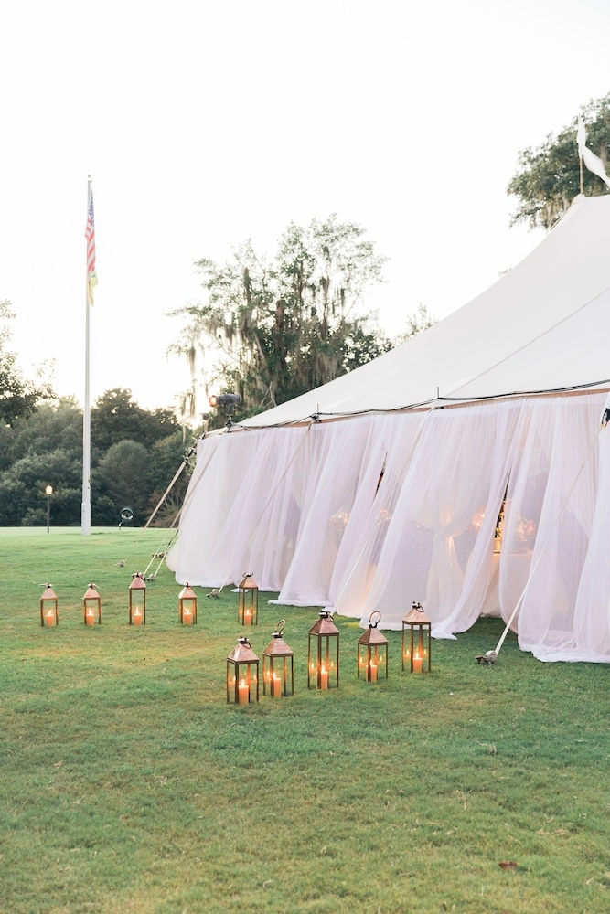 Tent by Sperry Tents Southeast. Wedding design by Easton Events. Image by Corbin Gurkin Photography at Yeamans Hall Club.
