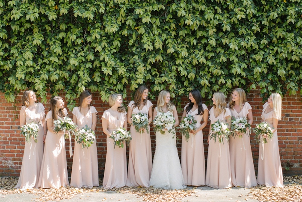 Bride's gown by Monique Lhuillier (available locally at Maddison Row). Bridesmaid dresses by Jenny Yoo (available locally at Bella Bridesmaids and Fabulous Frocks). Bouquets by Sara York Grimshaw Designs. Photograph by Sean Money + Elizabeth Fay.