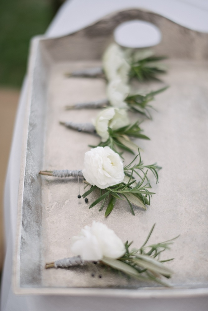 Boutonnieres by Sara York Grimshaw Designs. Photograph by Sean Money + Elizabeth Fay.