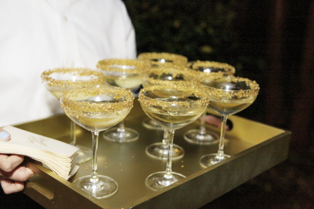 Rim coupe glasses with gold sugar for thematic (and edible) trimming. Image by The Connellys.