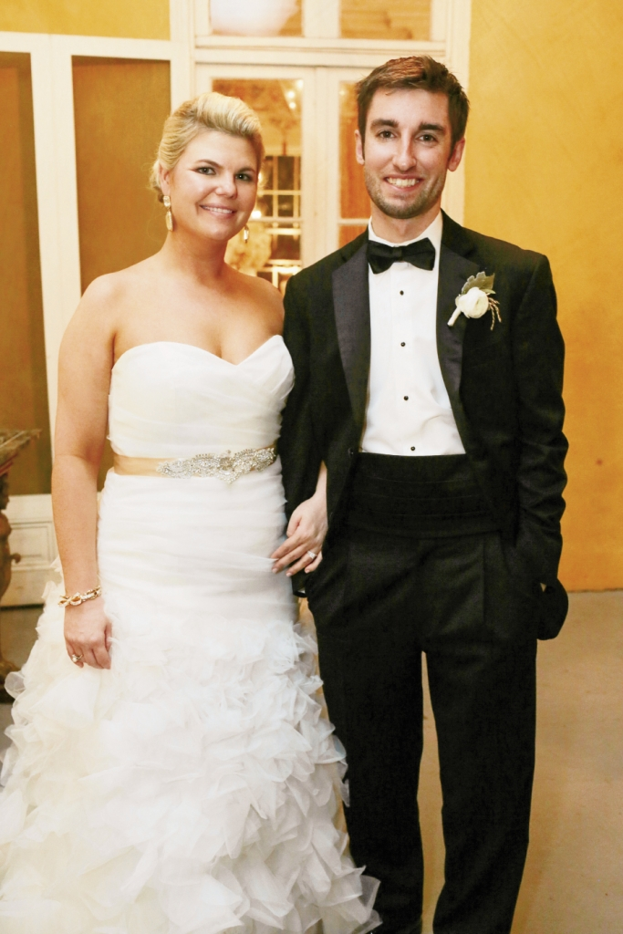 She wore Monique Lhuillier from Maddison Row; he wore a tux from Berlin's.