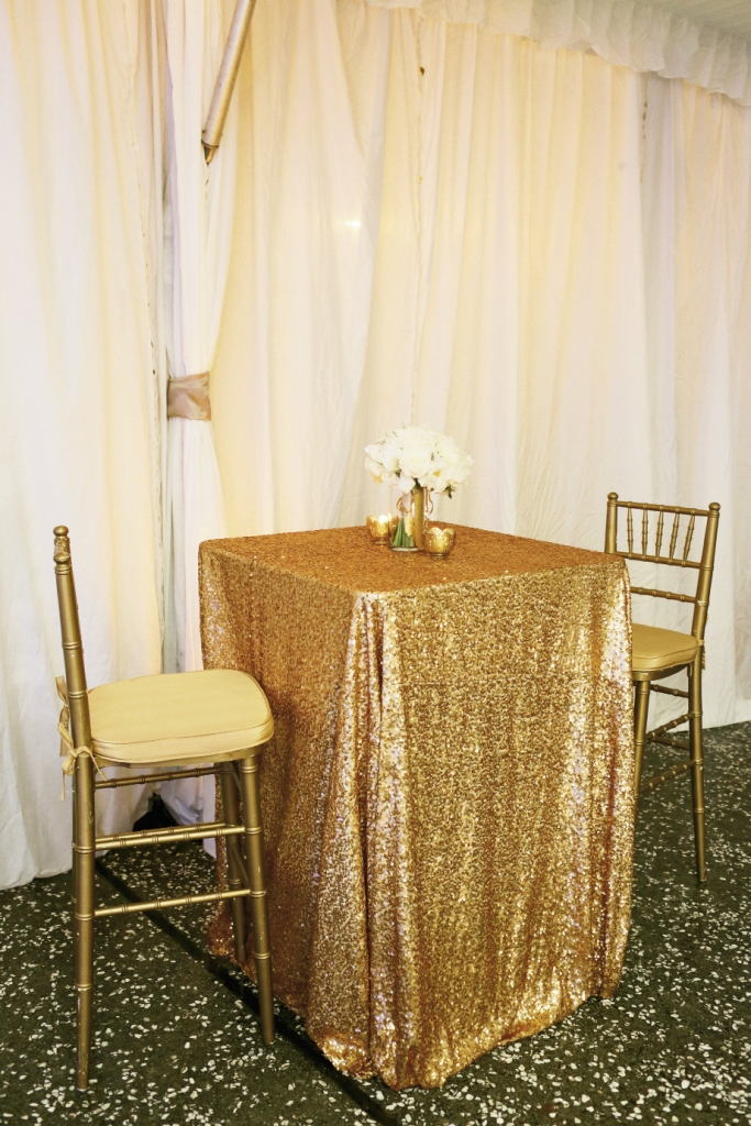 Cover small cocktail tables—rather than large dining tables—in your priciest and showiest fabric to save money and pace your style statements. Linens by La Tavola. Rentals by EventWorks. Image by The Connellys.