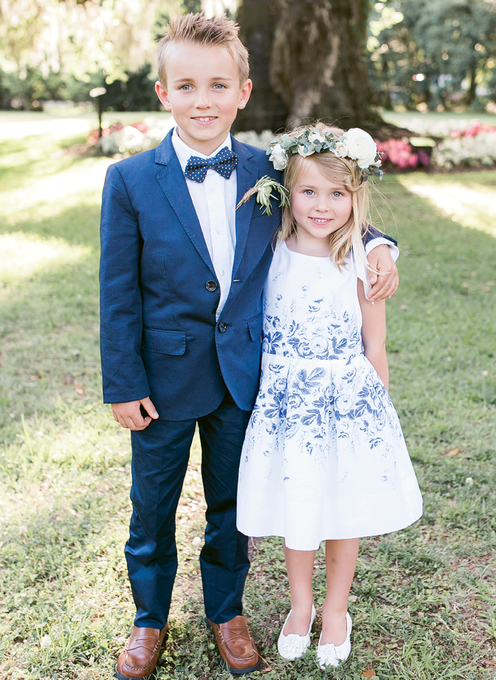 "First cousins to the bride (and offspring of one of her bridesmaids), Blake and Taelen served as junior usher and flower girl in the Souders-Colao wedding. ""Taelen,"" says Brittney, ""set the stage for me to walk down the aisle by passing out petals individually to guests."" Image by Jenna Marie Weddings"