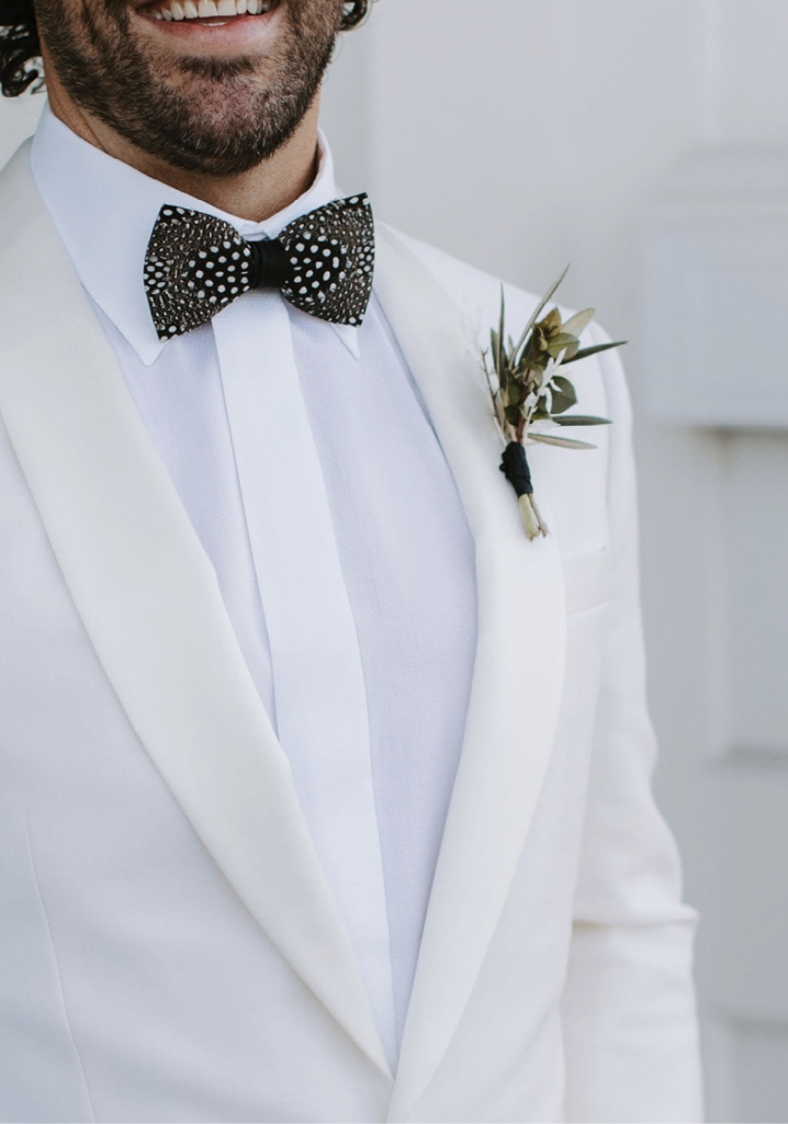 The flowers by Roadside Blooms balanced drama with simplicity, as did Mattie's statement bow tie by Brackish, set against his white J. Crew suit jacket.