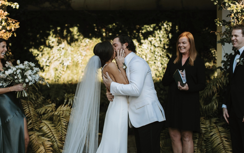 """""""The love was palpable to every person in attendance,"""" event designer Amy DeVito says. The personalized ceremony was even more touching because Mattie's wedding ring belonged to Brittany's late father. And Brittany's veil—stunning with original pearls, Chantilly lace, and raw silk—was custom made by Nadya D. Studio from her mother's wedding gown."""