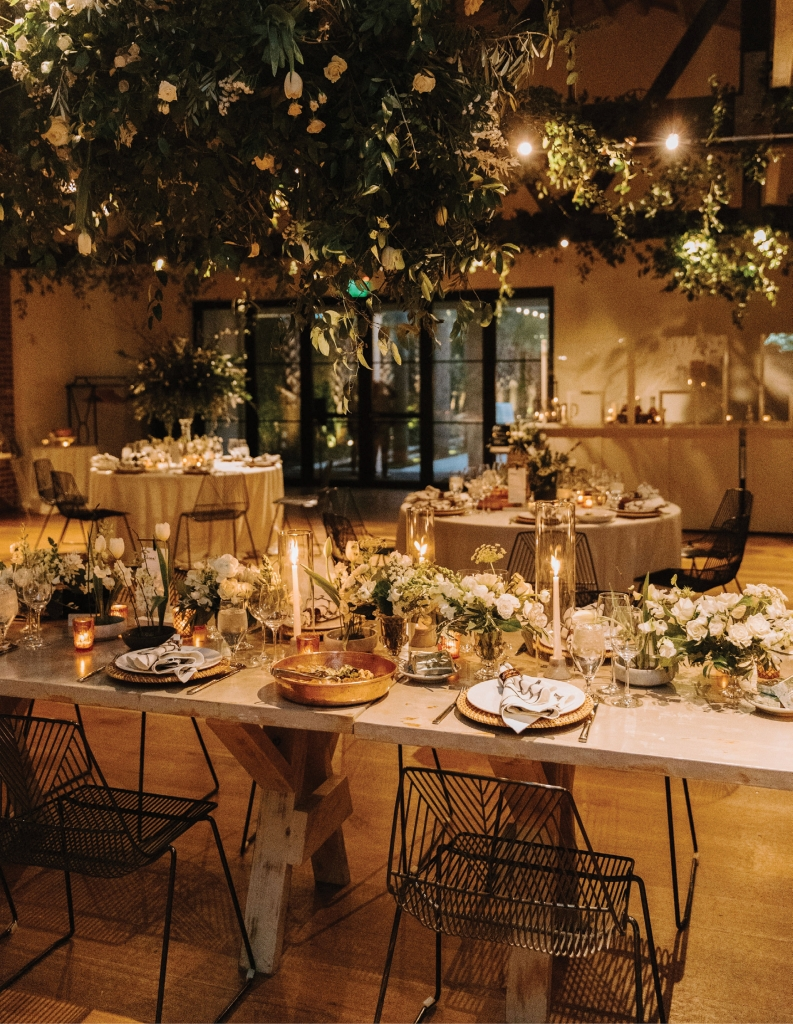 """""""We wanted timeless but bold, classic but a bit Old Hollywood,"""" explains the bride. Details like the gold chargers and art deco-style chairs helped create this feel."""