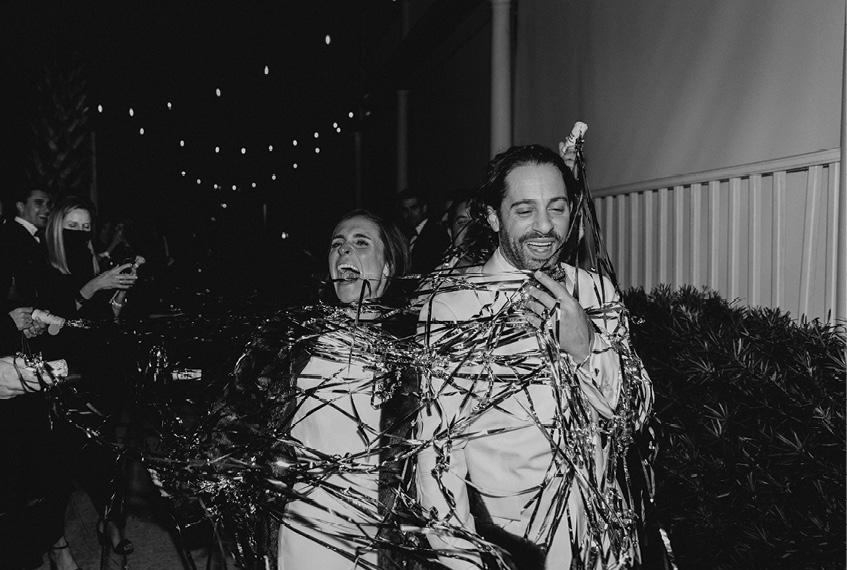 For their send-off, pop-out streamers enveloped the couple in a riot of ribbon and laughter.