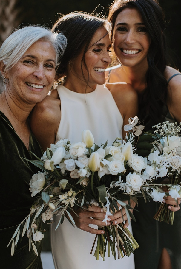 """Family was at the center of the day from start to finish. Brittany's mother and sister were her matron and maid of honor, while her brothers, Blaine and Bryan, walked her down the aisle, as their father had recently passed away. """"I love that it became innately so much more intimate that way."""""""