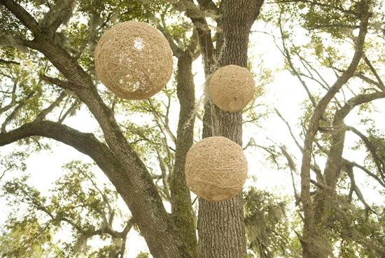 OUTDOOR ORBS: A windy storm rolled through just before the ceremony began, so most some décor, including colorful prayer flags, were taken down or moved under the tents by Lee's family. These twine balls, however, remained hanging with rustic charm.