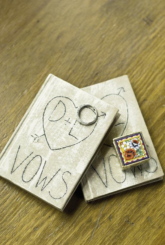 BOOK IT: The couple's monogrammed, faux-vintage vow books came from the Etsy shop BraggingBags. The mosaic ring box belonged to Lee's grandmother.