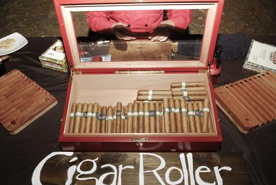 WORK HARD, PLAY HARD: Dave, who is founder and principal of the local company Cigar Row, had a employee man a rolling station during the reception.