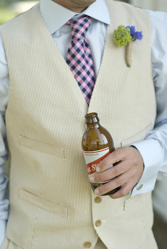 IT'S THE LITTLE THINGS: Duvall Catering & Event Design fashioned a twine-garnished wildflower boutonniere to complement the groom's off-the-rack J.Crew suit. The bar, which was stocked with the couple's drink of choice, Red Stripe, was open for guests before and during the ceremony.