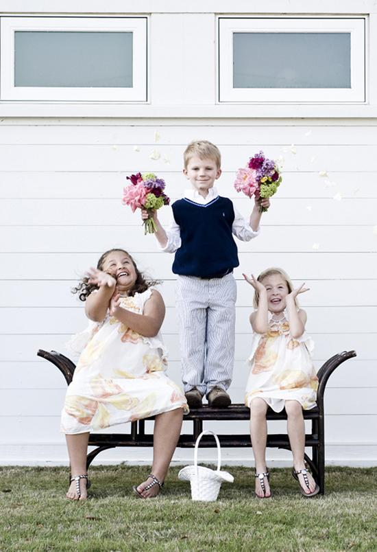 PRETTY AS A PETAL: Ring bearer Aaron and flower girls Jade and Iris, all cousins of Lee's, made happy with wildflower bouquets.