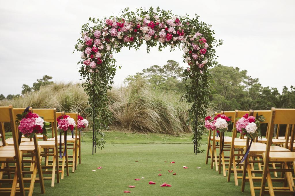 WALK THIS WAY: Again inspired by Shannon's Pinterest board, Gathering covered an arbor with a garden of pink hydrangeas, peonies, and roses.