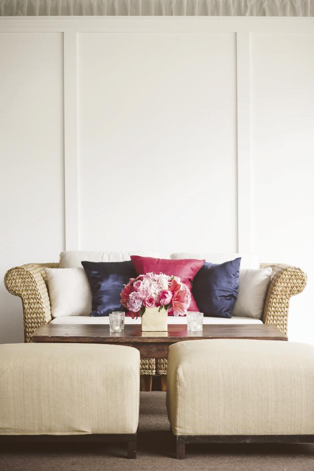 LOW-DOWN: Shannon's inspiration board on Pinterest featured low-slung seating, so Gathering recreated that feel with benches and love seats topped with champagne-colored cushions and navy and deep pink pillows.