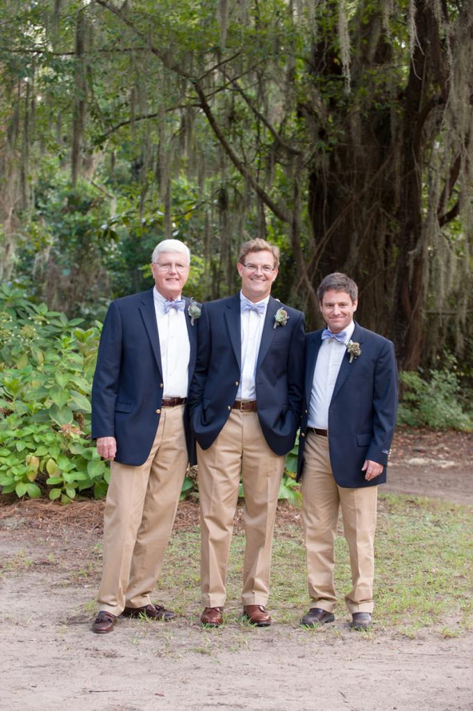 Groom and groomsmen's suits from Brooks Brothers. Ties by High Cotton. Boutonnieres by Forget Me Nots by Horst Florist. Image by Anne Liles Photography on Wadmalaw Island.