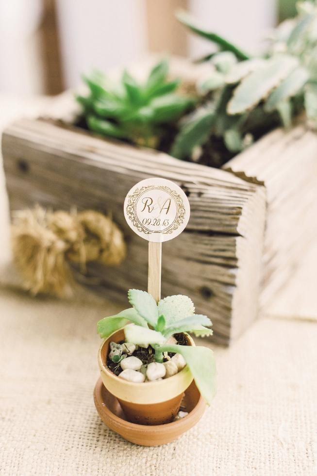 TAG, YOU'RE IT: Monogrammed sticks transformed miniature pots into thematic décor.