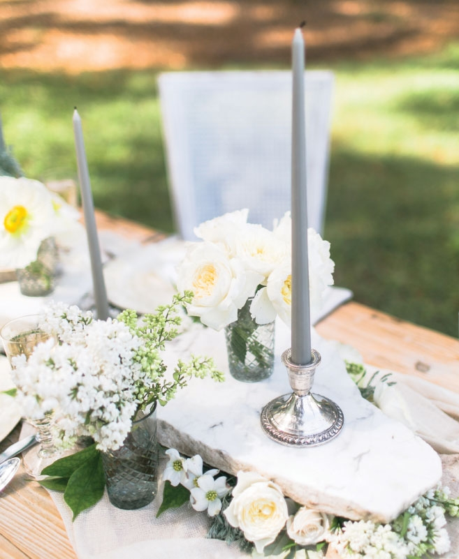 TIERS OF JOY: Try a stackable table runner (like Anne Dabney of Charleston Stems did here) to maximize space. She placed floral foam between marble slabs and then tucked blooms into the foam. The flat slab tops allow for candles, table numbers, bread baskets, and bouquets.