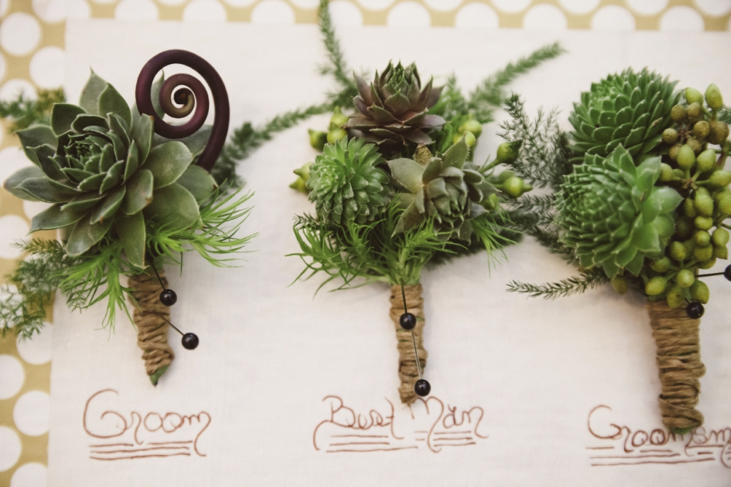 TOUGH STUFF: For sturdy boutonnieres that can stand up to a day's worth of hugs, try succulents tied off with hemp twine.