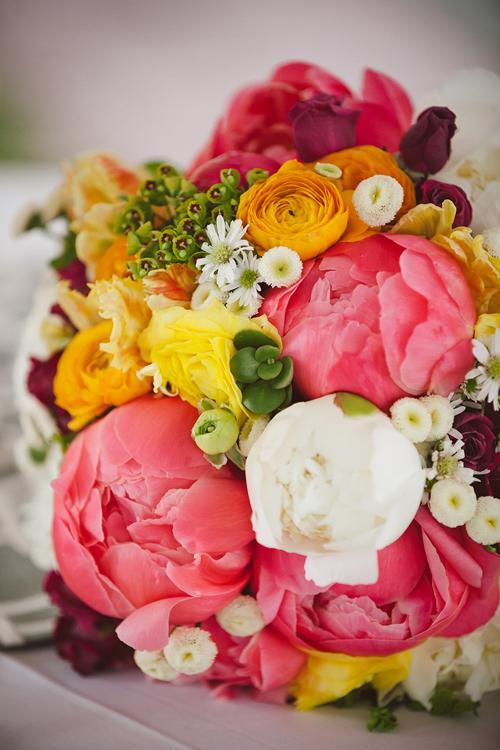 "TEA TIME: For a bouquet that had ""garden party"" written all over it, Jacqueline mixed chamomile buttons, coral charm and cream peonies, yellow ranunculus, raspberry tea roses, succulents, and yellow ruffled tulips."