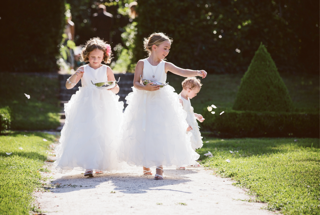 Catherine's nieces' ruffled flower-girl frocks were  pint-sized nods to her own tulle gown. <i>Amelia + Dan Photography</i>