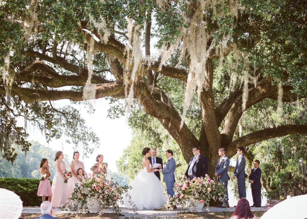 """We wanted the wedding to be both a classic taste of Charleston—the garden walk on arrival, sweet tea, hand fans, oak trees, shrimp 'n' grits, fried green tomatoes, 10-piece big band—and a highly progressive affair with Jared's one-time roommate serving as officiant,"" says the bride.  <i>Amelia + Dan Photography</i>"
