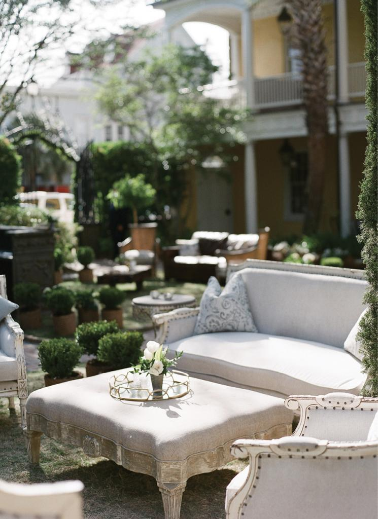 Lounge furniture was arranged in a series of sitting areas to break up the expansive lawn. Furniture covered in linen looked as though it could have been pulled from inside.