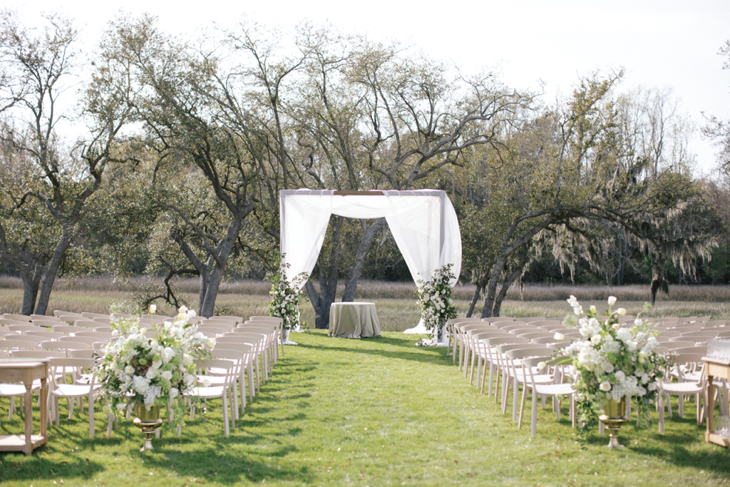 Under a simply draped arbor, the couple exchanged vows in an inter-faith ceremony conducted by both a rabbi and a priest.