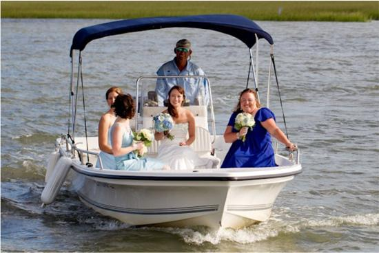 MIX N' MATCH: Cindy and her bridesmaids, who wore monochromatic blue dresses from David's Bridal and Ann Taylor, arrived to the ceremony via boat. The captain's boat shirt even color coordinated with the ladies' attire.