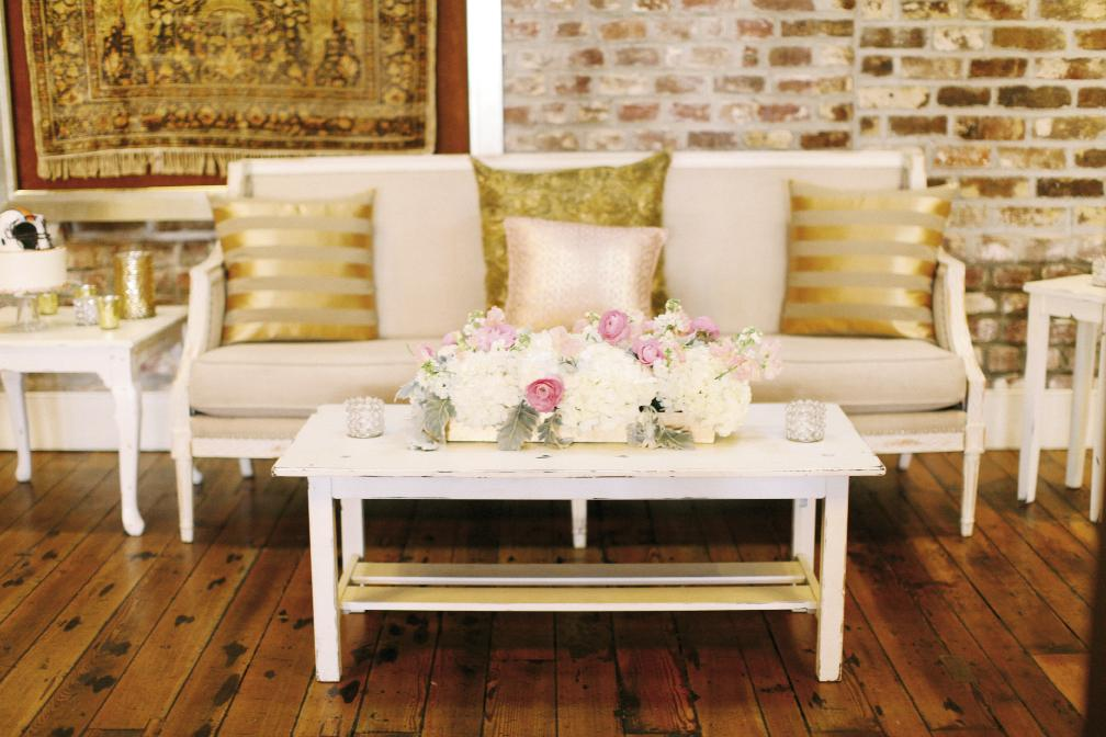 "Mix and match rental pieces with your own finds. Cory created lounges from EventHaus' ""Provence"" furniture, then upped the sparkle factor with gold-kissed pillows she sourced online."