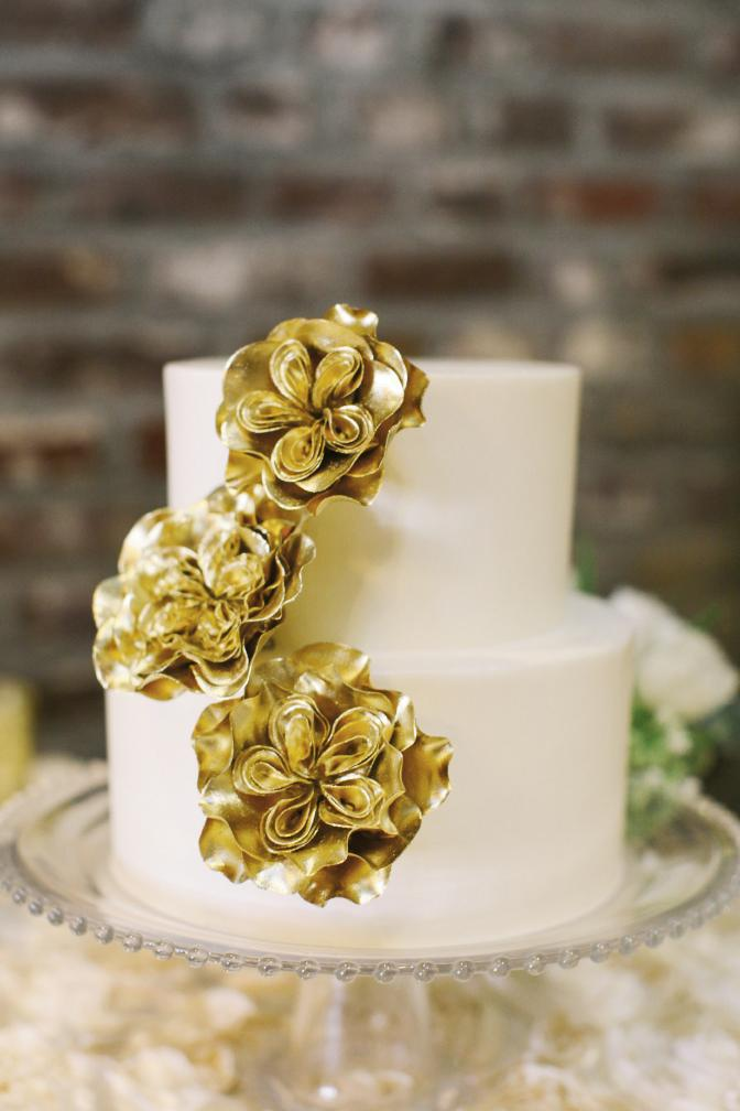 Molly Lawson of D'lish adorned this cake with handmade gilt flowers.
