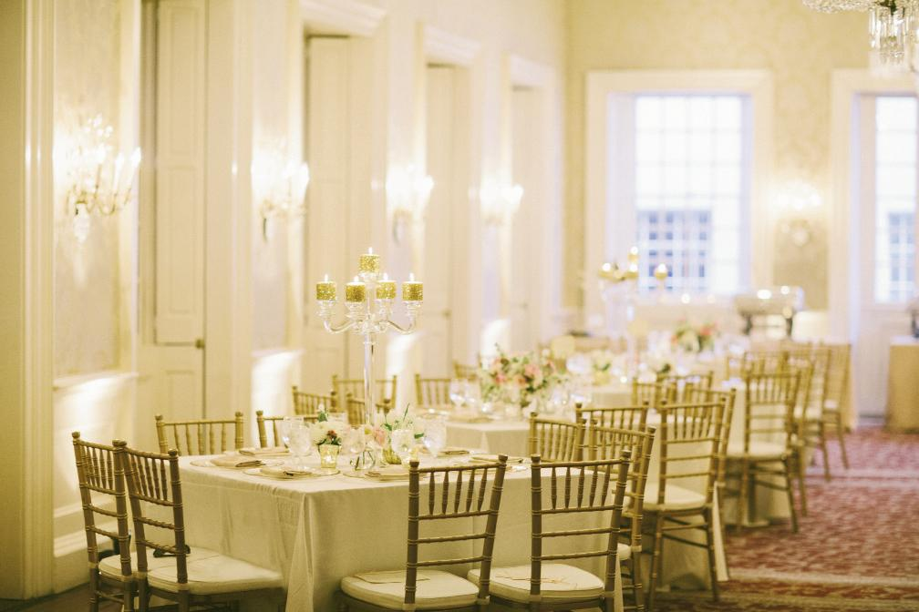 To set off the sparkling accents, incorporate neutrals—like pale linens, gold chiavari chairs, and clear crystal candelabras.
