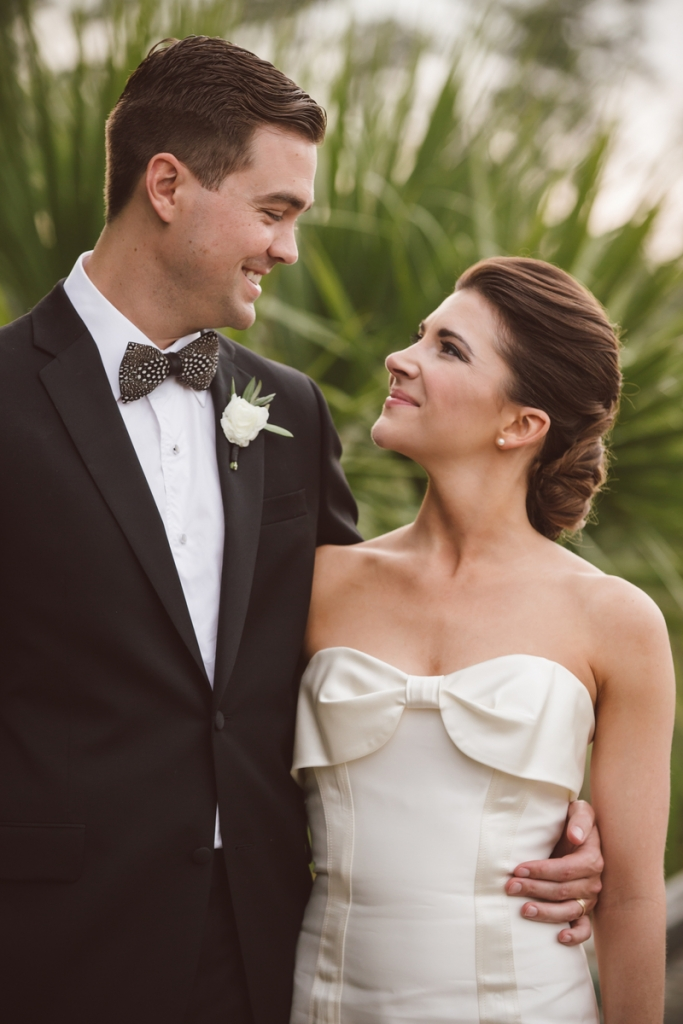 Bride's gown by Carolina Herrera (available locally at Fabulous Frocks). Bow tie from Brackish Bow Ties. Hair and makeup by Wedding Hair by Charlotte. Photograph by amelia + dan.